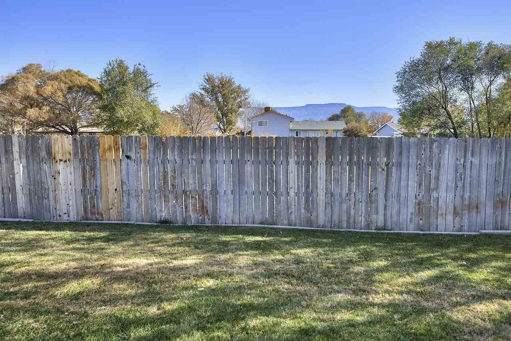 Privacy fenced and backs to an open field