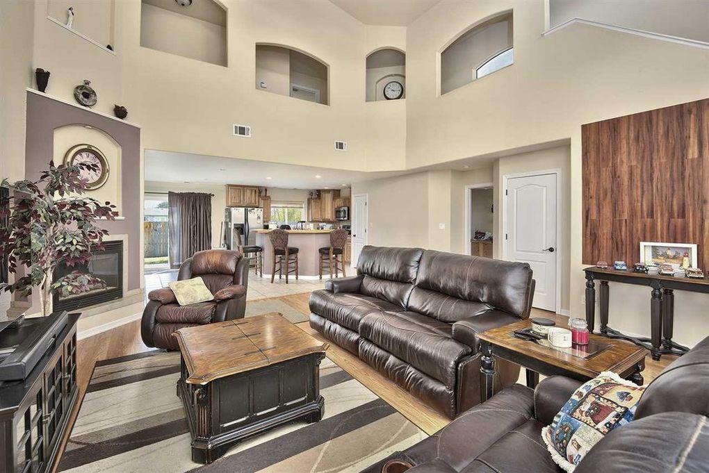 Living room features unique archways.