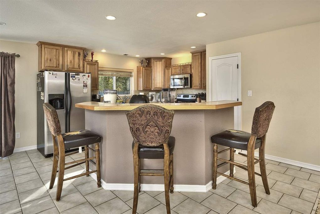 Nicely designed kitchen with pantry.