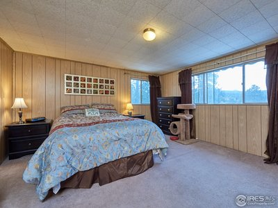 Upper level bedroom with mountain views