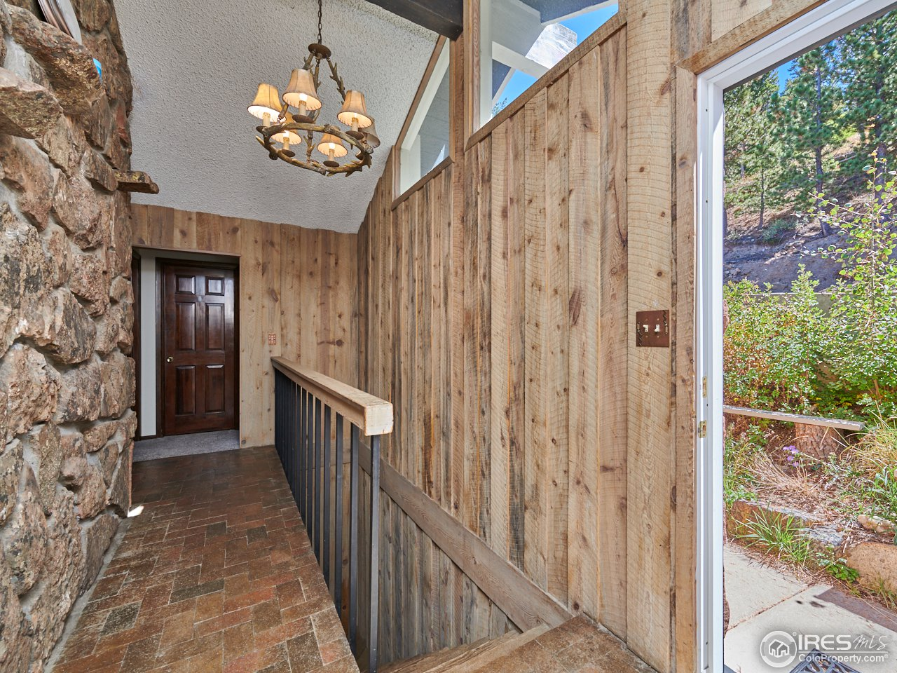 Entrance with brick floors