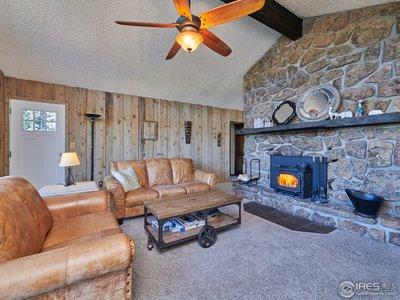 Multiple wood fireplaces w/ rock chimney