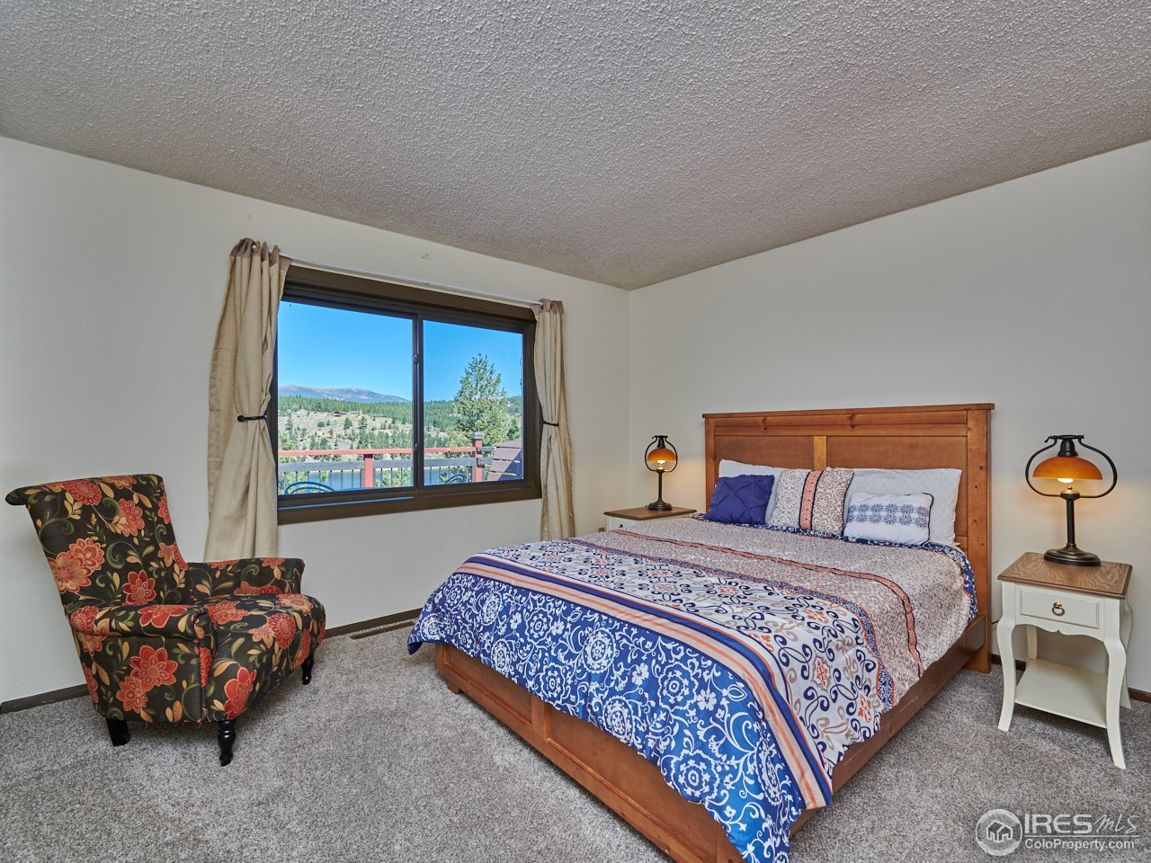 Main level master bedroom w/ water view