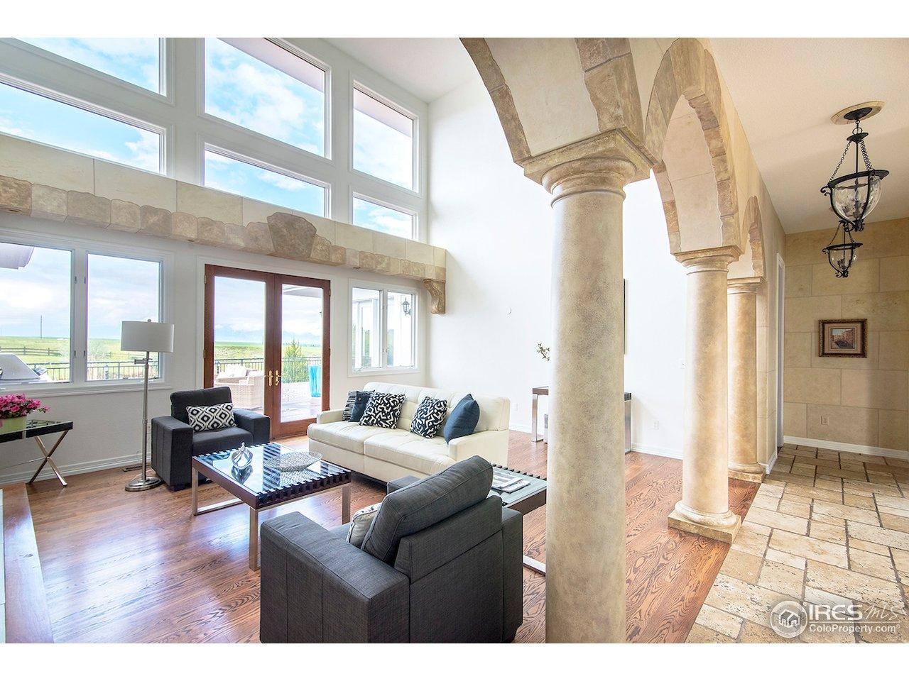 Floor to ceiling windows and doors to deck.