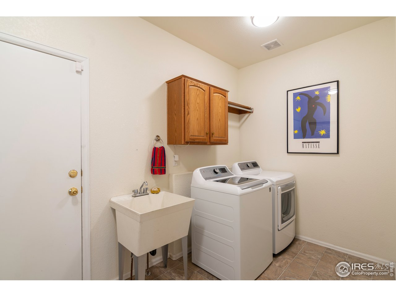 laundry room/ drop zone off of garage- washer and dryer included