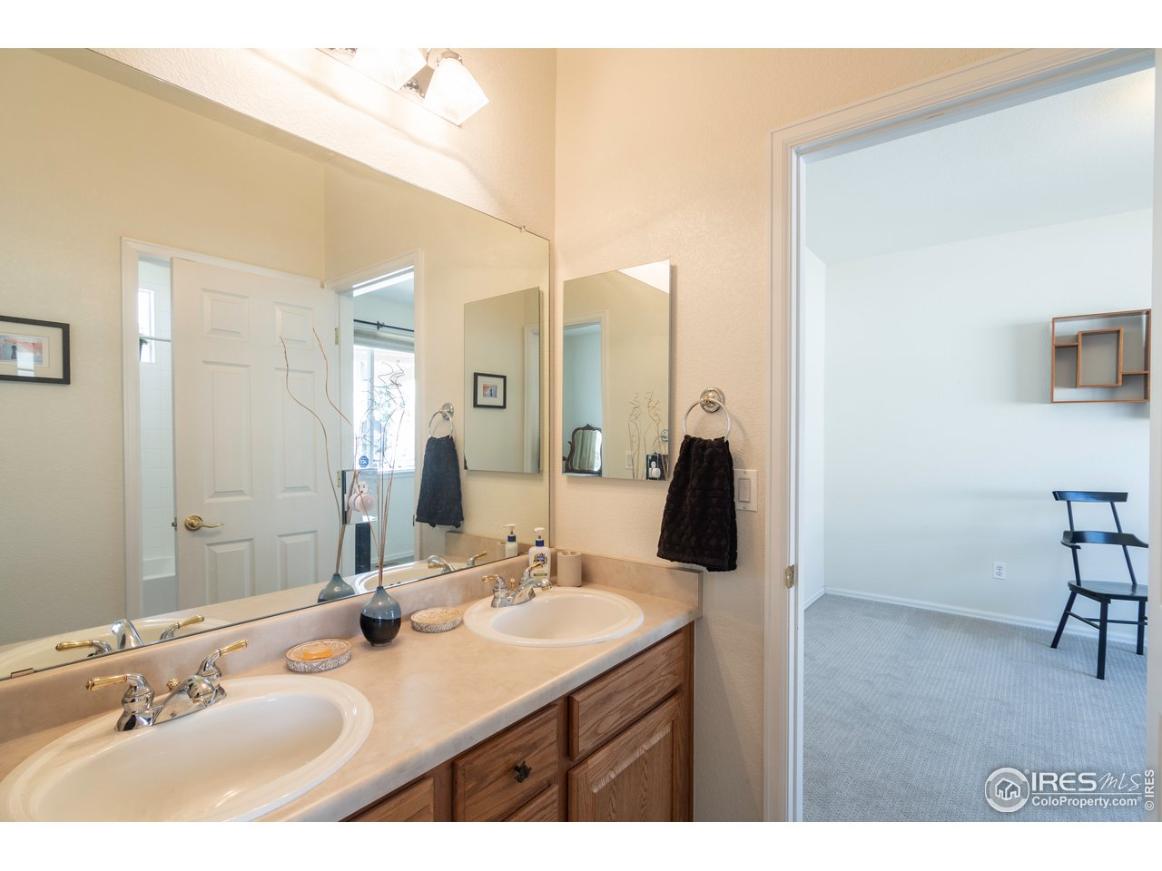 double sinks in jack and jill bath between 2nd and 3rd bedrooms