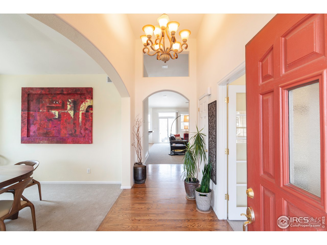 Beautiful high ceilings and gorgeous hardwood floors in the entryway