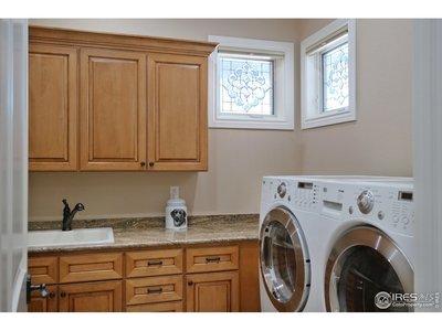 Main Level Laundry w/Sink & Storage Cabinets