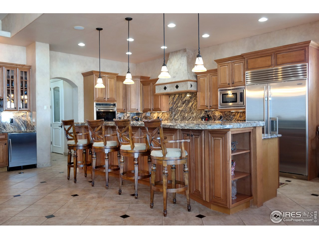 Gourmet Kitchen has Extended Bar & Custom Granite