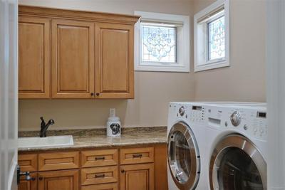 Main Level Laundry w/Sink & Storage Cabinets