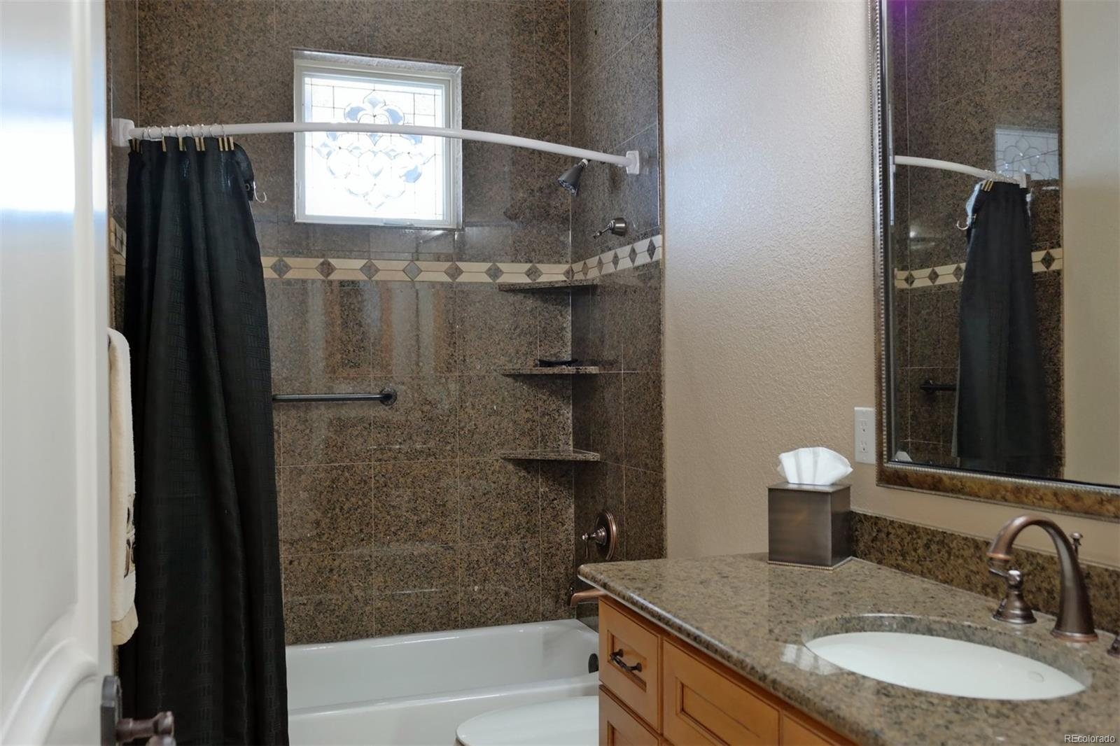 Main Level Full Bath w/Upgraded Tile Finishes
