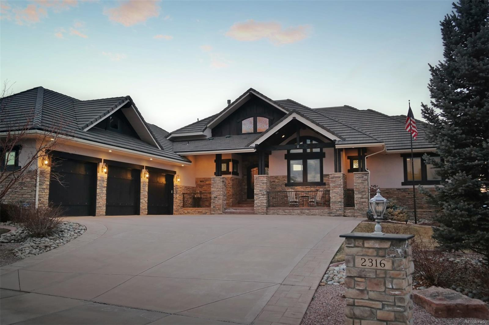 Dramatic Stone & Stucco Exterior w/Tile Roof