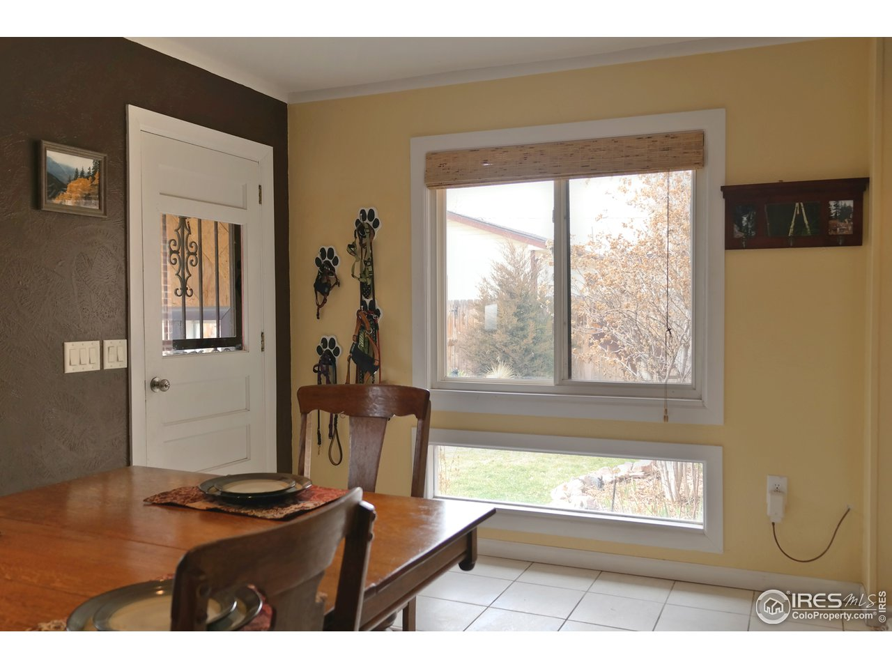 Door to Backyard & Oversized Windows in Dining Rm