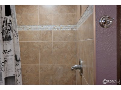 Sparkling Tile Shower in 3/4 Basement Bath