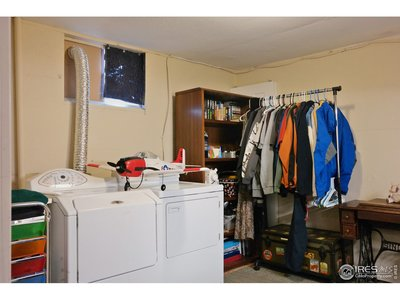 Spacious Laundry Room Provides Storage Space