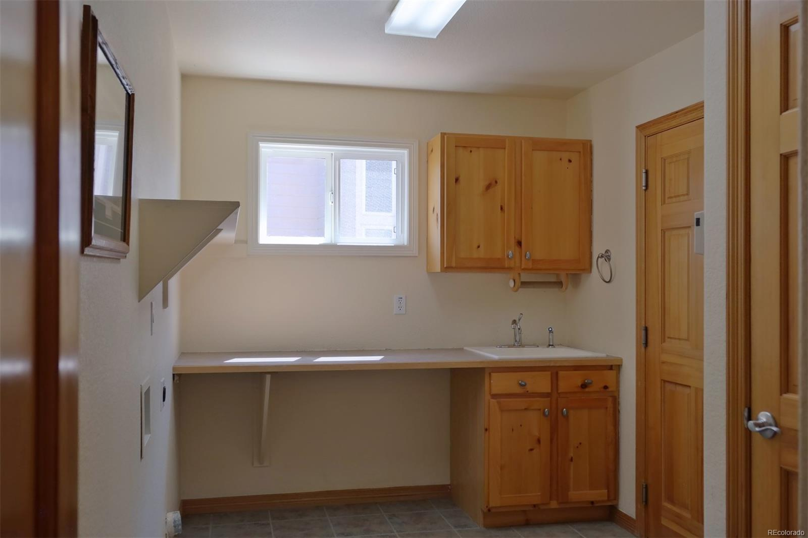 Laundry Rm w/Deep Sink, Cabinets & Folding Counter