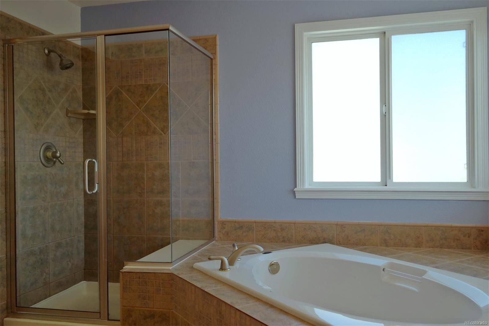 Attractive Tile & New Shower Glass in Master