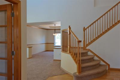 Spacious Entry w/High Ceilings & Formal Staircase
