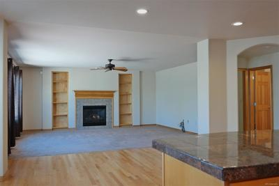 Gas Fireplace Enjoyed from Family Room & Kitchen