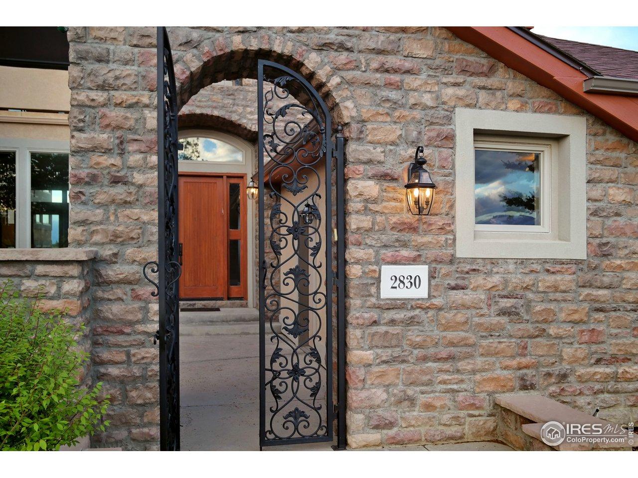 Stunning Gated Entry & Custom Front Door