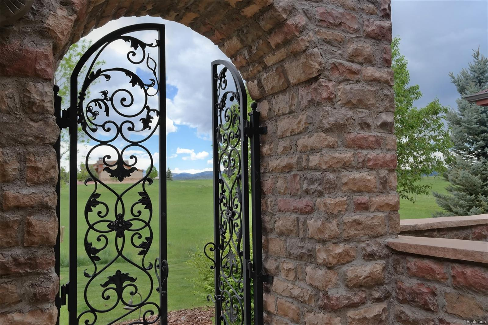 Unique Iron Gates at Front Entry