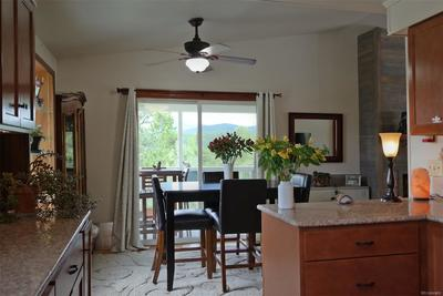 Dining Area Convenient to Kitchen & Outdoor Deck
