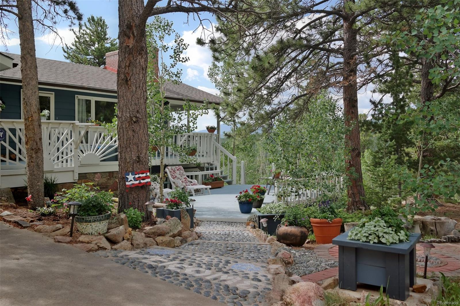 Sweet Tree-Lined Stone Path Leading to Front Door
