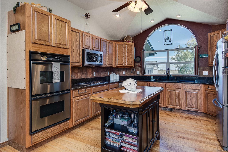 Great counter space-a chefs delight! Designer stone backsplash, hardwood floors,