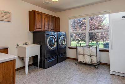 Great laundry room, built-in cabinetry with tub sink and counter for folding, wa