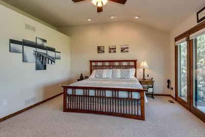 High ceilings, recessed lighting, and ceiling fan