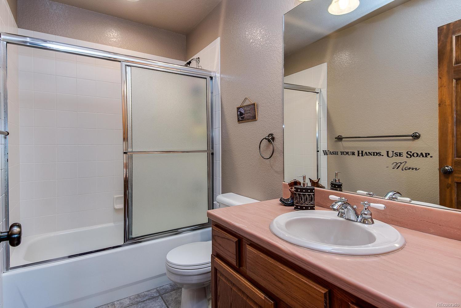 Vanity with storage space, soaking tub and shower