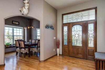 Elegant front door opens to spacious entry