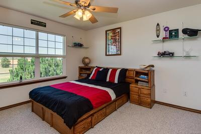 Spacious, bright and cheery, closet with 6 panel solid wood doors