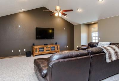 Upper level entertainment room with guest suite