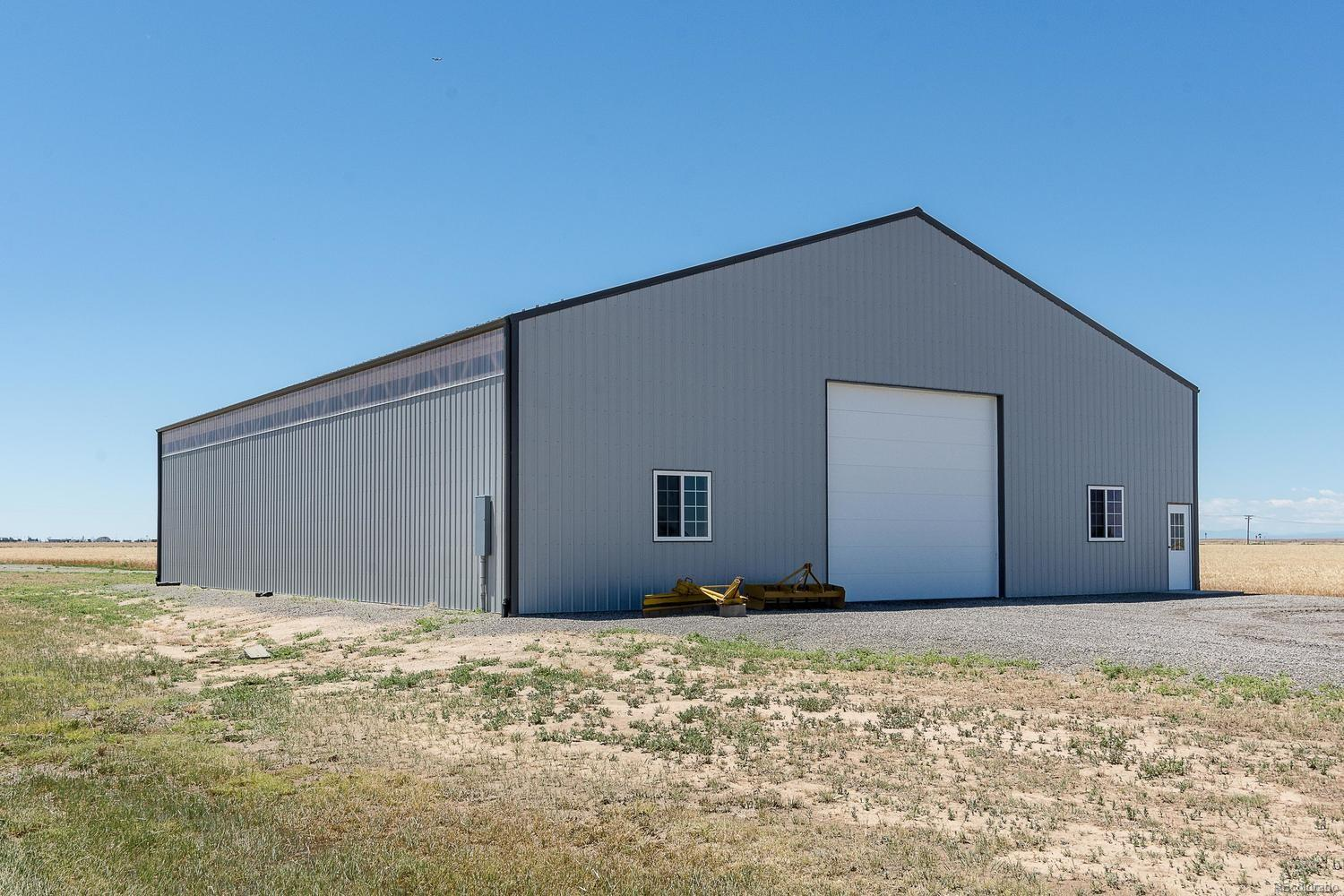 Massive steel building with 200 amp 240 service, pass through doors, elevated st