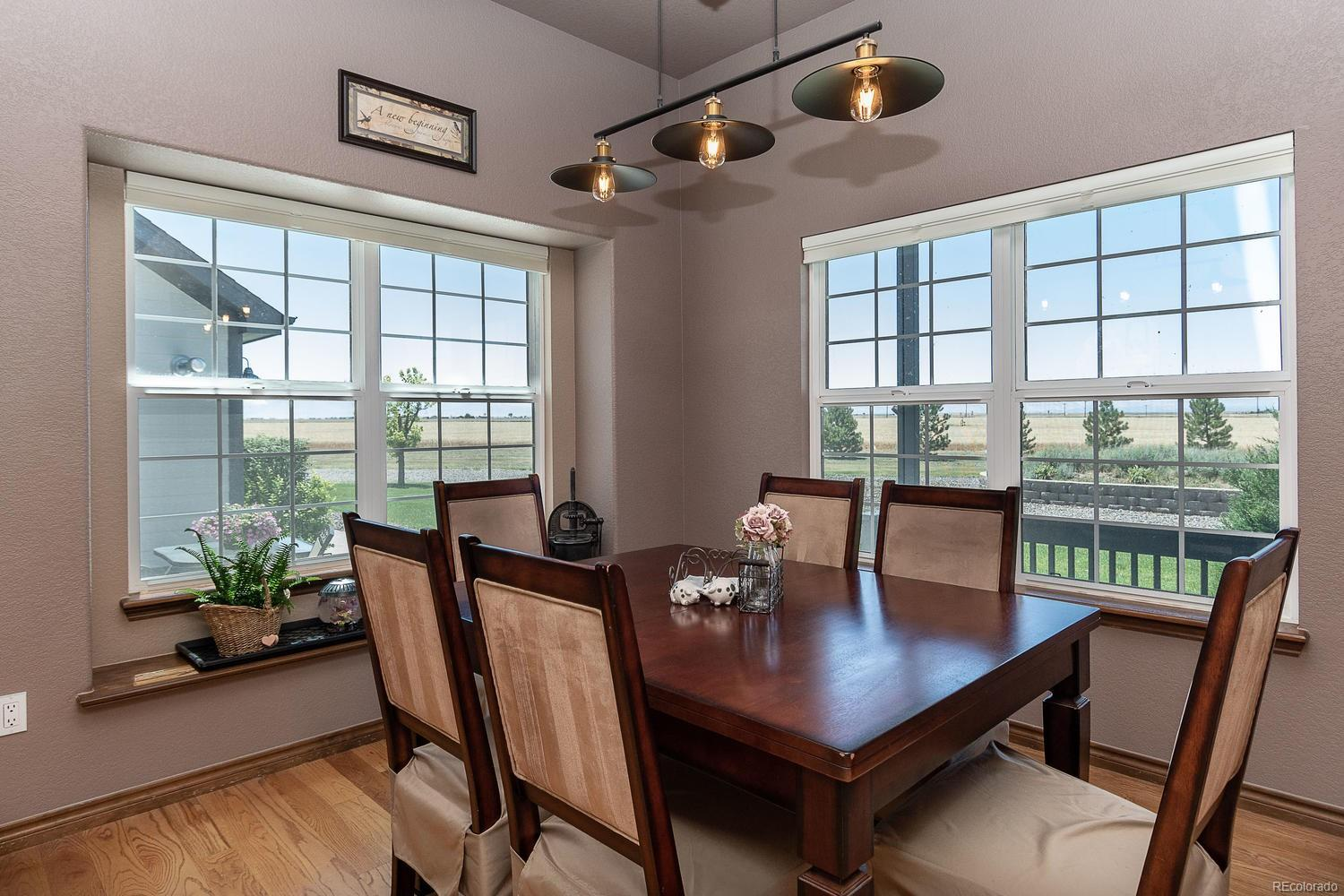 Formal dining room, hardwood floors, two walls of windows, chandelier for attrac