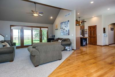 Gorgeous glass windows and door open to spectacular yard and covered patio