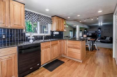 Entertain in the updated gourmet kitchen featuring granite counters, kitchen peninsula and an abundance of cabinet space