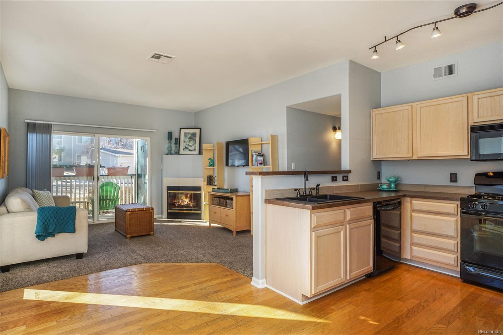 You will love the bright & open floorplan with hardwoods, new carpet & paint!