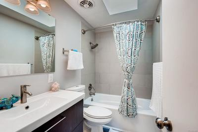 Full main floor bath with modern finishes, skylight & more!
