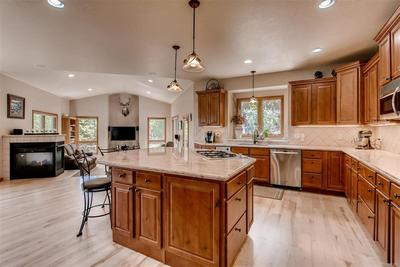 You can enjoy the open floor plan from the kitchen as you see into the family ro
