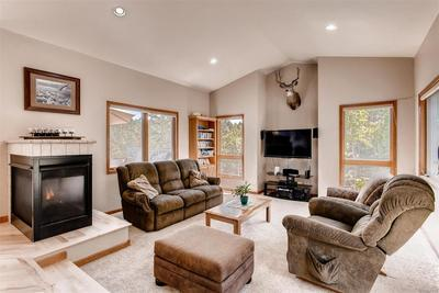 The sunken family room is a wonderful place to relax. The fireplace keeps you co