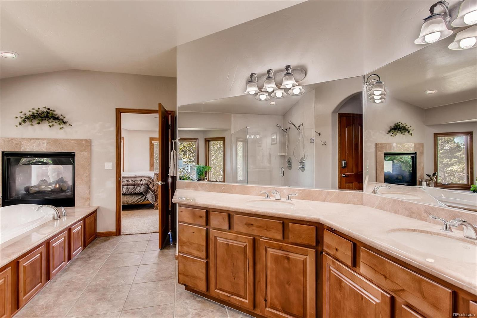 There is lots of counter space in the master bath so both parties can spread out