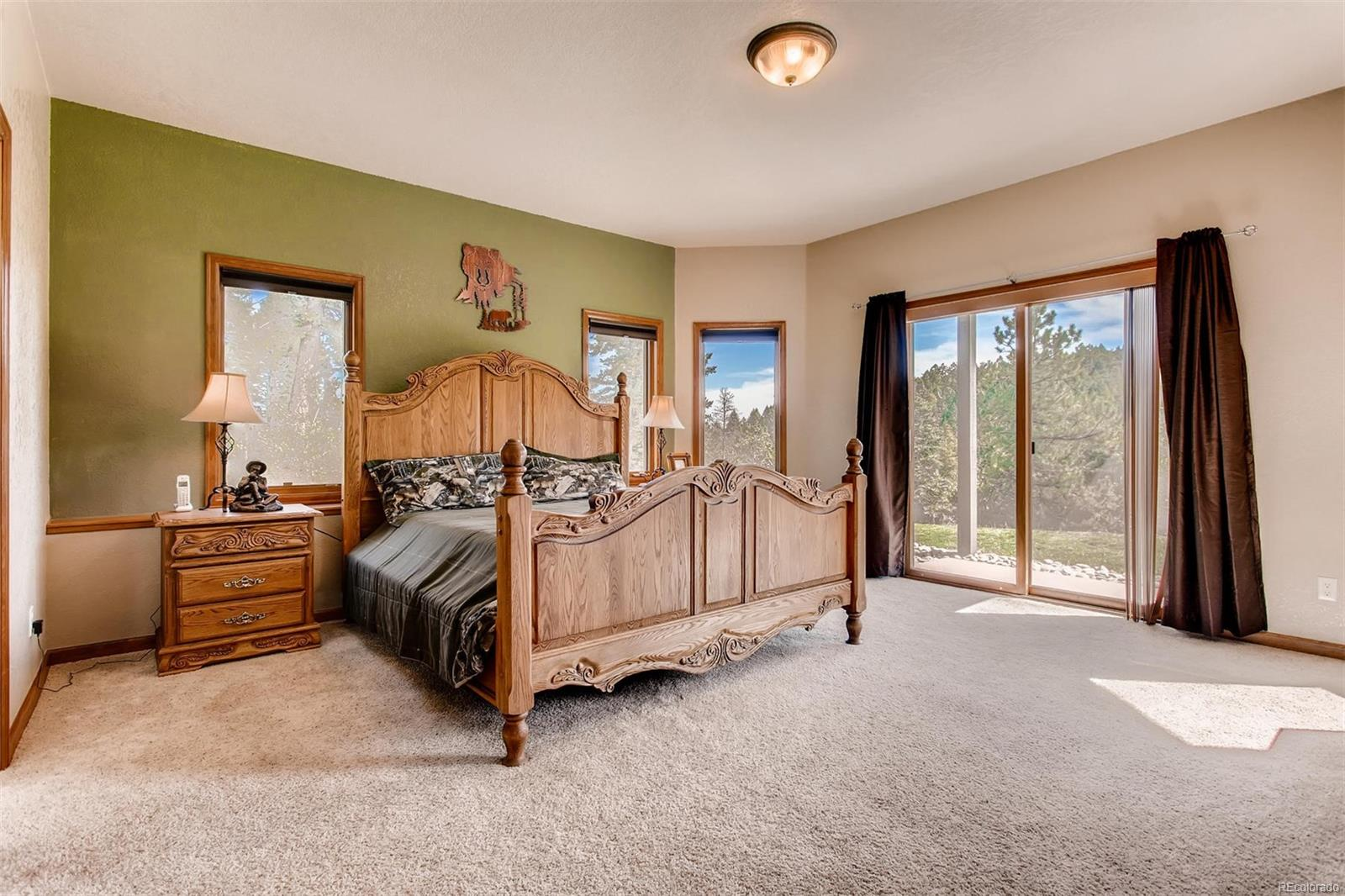 This large bedroom has access to one of the patios. The very large closet and ja