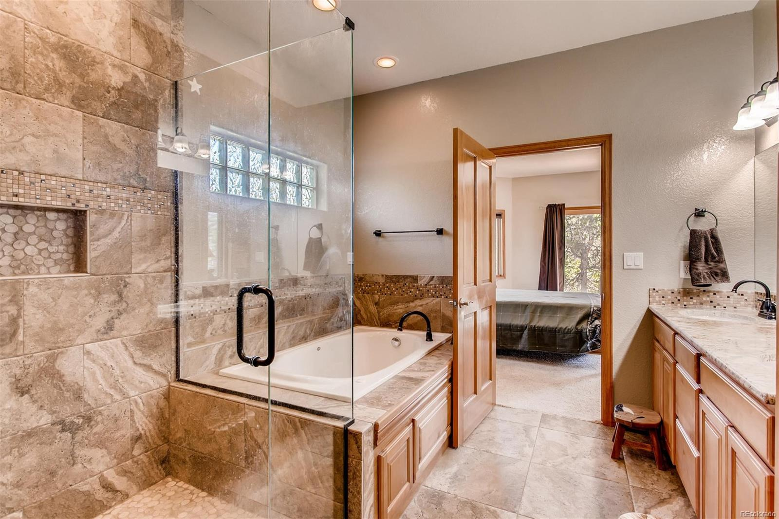 The jack-and-jill bathroom is spectacular! From the large tub to the gorgeous sh