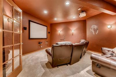 I know you weren't expecting it but the fabulous home theater is where you'll lo