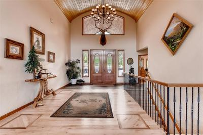This entryway is incredible! The beautiful floor inlays provide an attention to