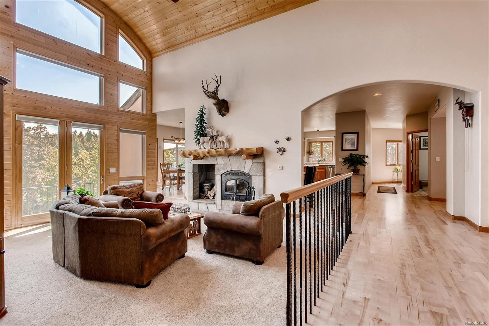 Just in front of the entry is the living room - with the wood burning fireplace