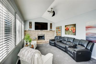 The family room is cozy and inviting. The natural light from the backyard makes this space very welcoming.