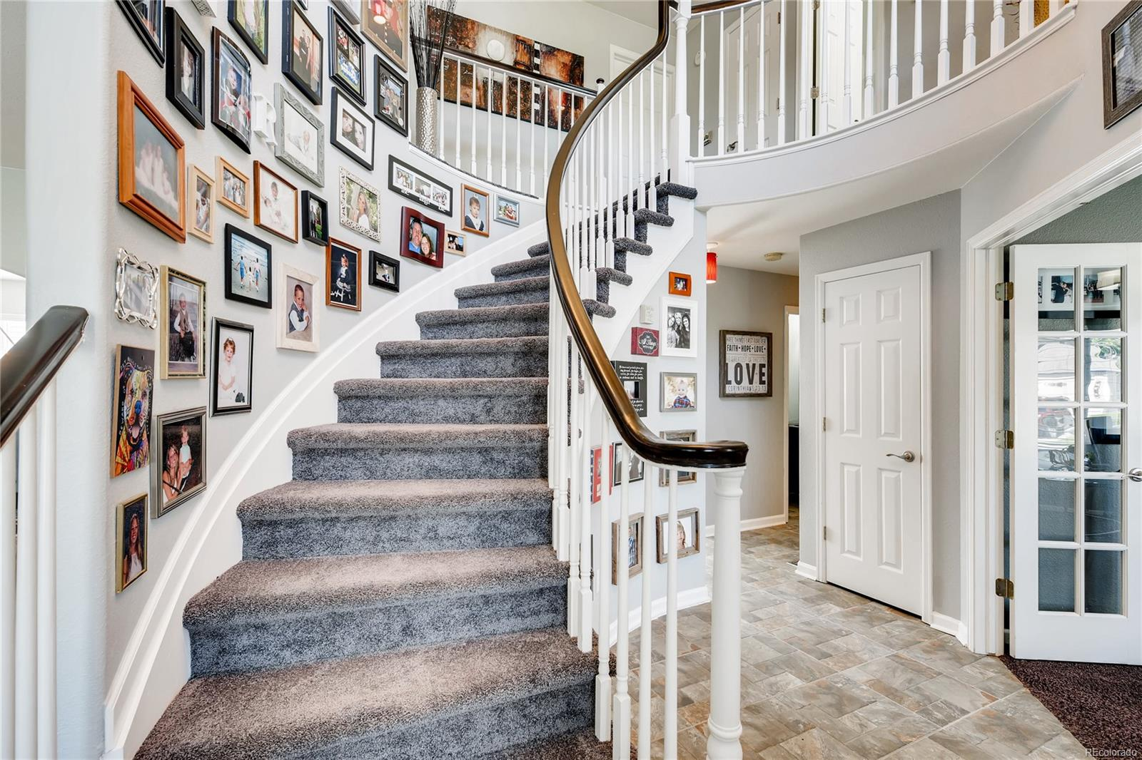 The staircase off the entry is a beautiful focal point of the home.